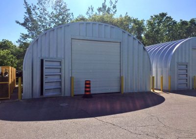 Metal Quonset Hut Storage Building with garage door