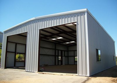 Prefab Metal Storage Building for sale with two large car doors